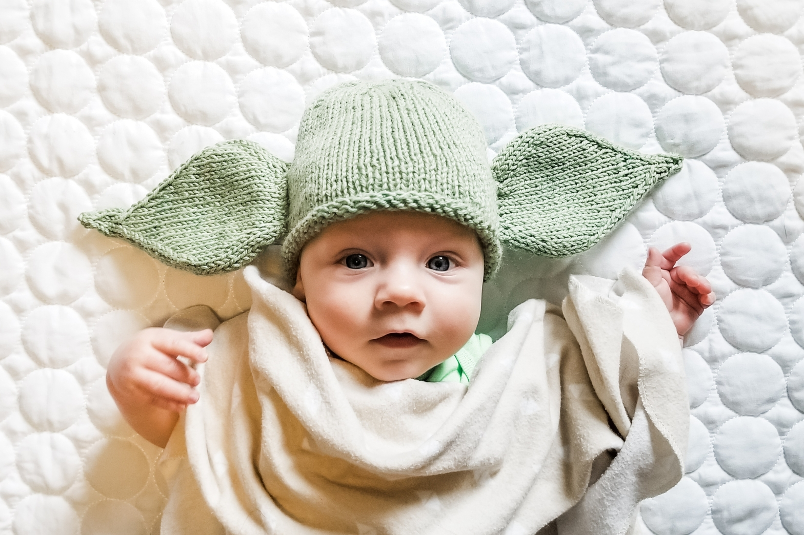 Baby wearing a knit Yoda hat